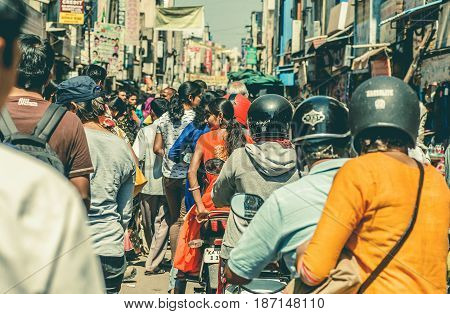BANGALORE, INDIA - FEB 12, 2017: Many drivers on motorcycles moving past busy indian street of crowded area on February 12, 2017. With population 8.52 million Bangalore is 3-rd most populous indian city