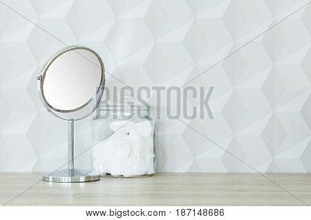 Round Mirror And Cotton Jar