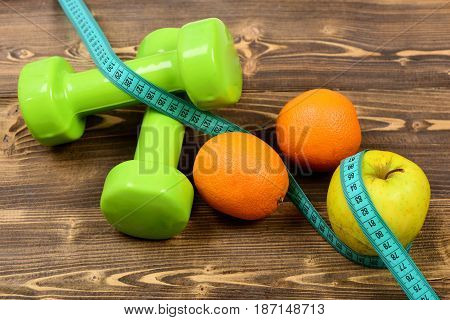 Dumbbells Weight With Measuring Tape, Apple, Orange, Diet Concept