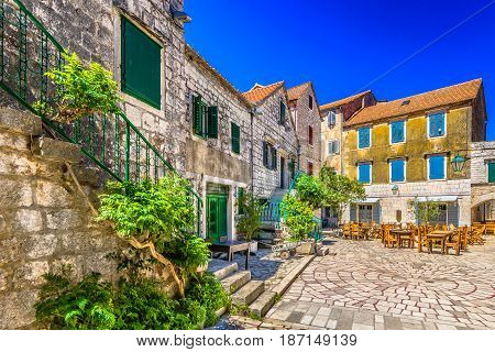 Colorful stone architecture at 2400 years old square in old town Stari Grad (Pharos) Island Hvar scenery, Croatia.