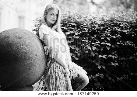 Stylish Blonde Woman Wear At Jeans And Girl Sleeveless With White Shirt Against Bushes At Street. Fa