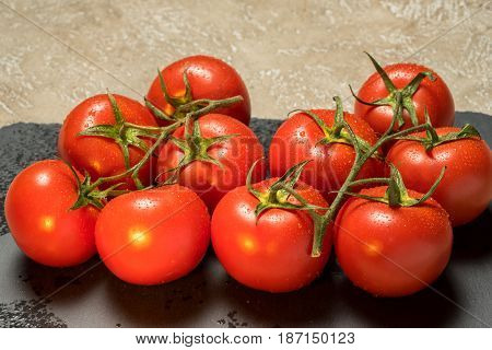 bunch of red ripe wet tomatoes close up