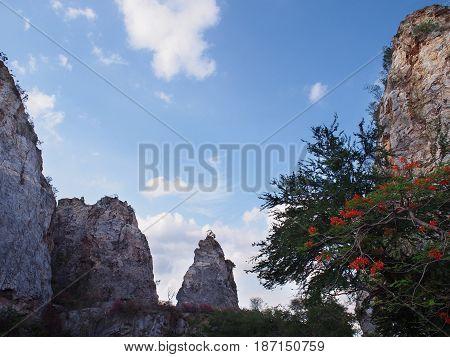 High mountain against blue sky at Khao Ngoo Rock Park or Thueak Khao Ngu Ratchaburi Province Thailand.