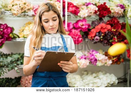 Florist Working On A Flower Inventory
