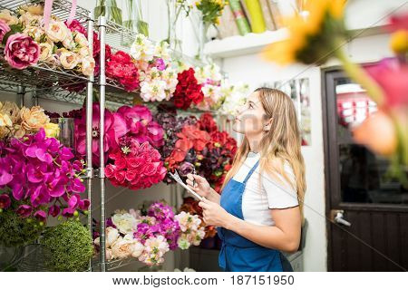 Florist Choosing Flowers From A Colorful Inventory
