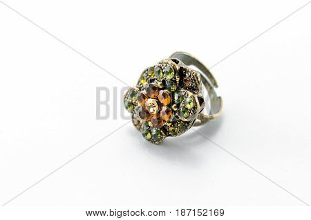 Old vintage ring with gems isolated on white background.