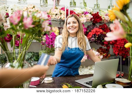 Florist Taking A Credit Card Payment