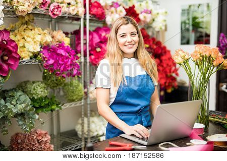 Florist Doing A Research On Her Computer