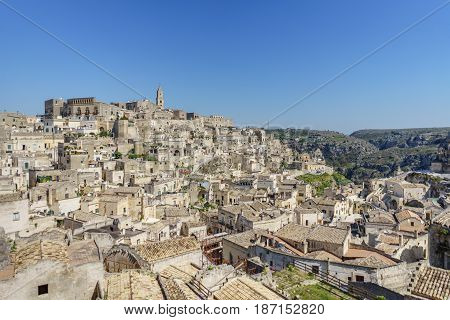 beautiful horizon of ancient ghost town of Matera (Sassi di Matera) in beautiful bright sun shine with blue sky south Italy.