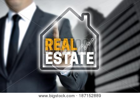 Real Estate Touchscreen Is Operated By Businessman
