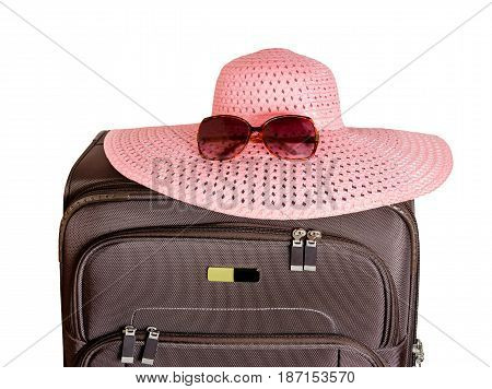 Brown suitcase sunglasses and hat isolated on white background