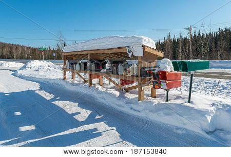 Post office boxes beside on street in Alaska