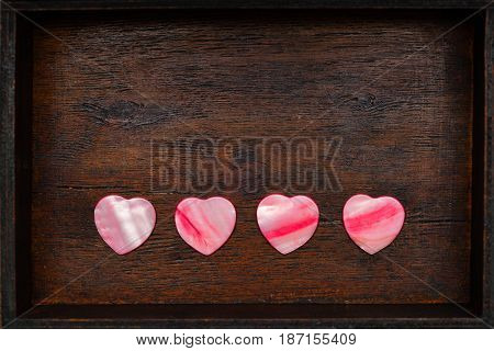 ornamental hearts on the vintage background of old wood surface