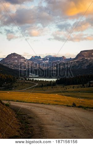 Gravel road and view of mountains Beartooth pass Montana