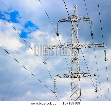 High metal construction against the sky it's power lines wires high above the ground carefully high voltage