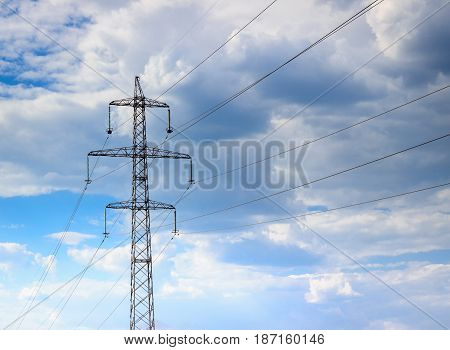 Nicely stretched wires against the blue sky on them goes current high voltage dangerous for life