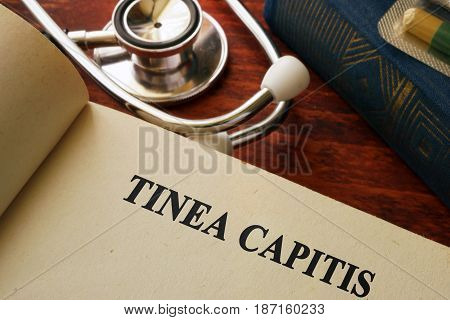 Book with title Tinea capitis. Medical concept.