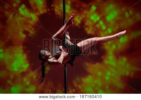 MOSCOW, RUSSIA - FEB 11, 2017: Participant of Pole Dance Show performs on stage in Korolevskiy concert hall. Concert hall is designed for 750 spectators.
