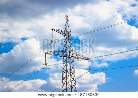 Electricity against the blue sky is a very beautiful view the tip of a high metal construction along which wires stretch