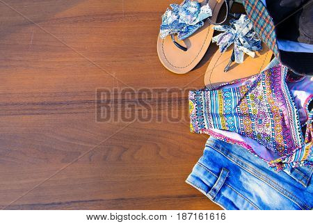 Set Of Beachwear On Wooden Background