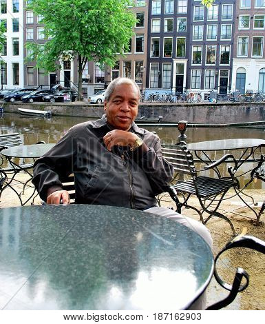 African american male tourist relaxing in Amsterdam, Netherlands.