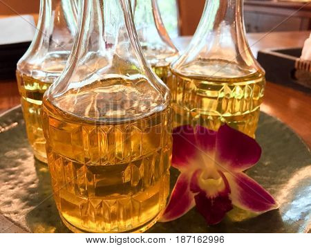 Aromatherapy Oil in Glass Bottles with Orchid are Well-Prepare for Use in Spa and Wellness