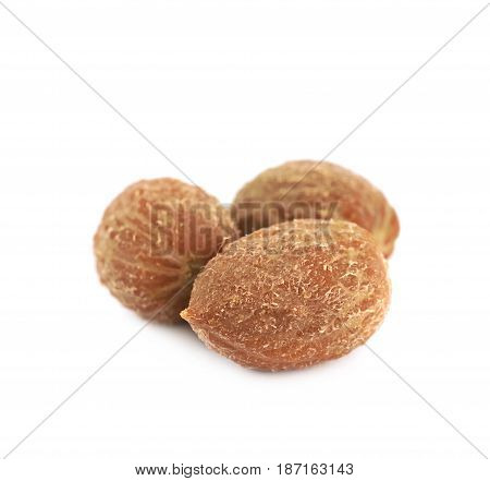 Pile of green olive pits isolated over the white background
