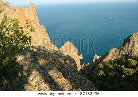 Panoramic Crimean landscape - Karadag volcanic mountain range - Ukrainian natural reserve on a Black Sea shore.