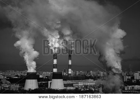 Industrial area of the city, smokestack pipes smoke mercilessly