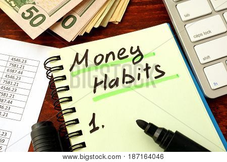 Notepad with word Money Habits. Saving and planning concept.