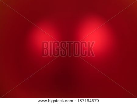 Bright red background with two bright spots in the center