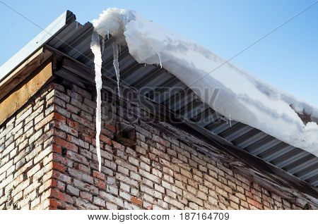 Icicles on the building roof in spring.