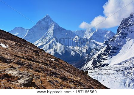 Majestic Ama Dablam Mountain On The Background Of Blue Sky, Nepal.