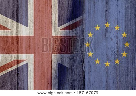 Relationship between the Britain and EU The flags of Britain and European Union merged on weathered wood 3D Illustration