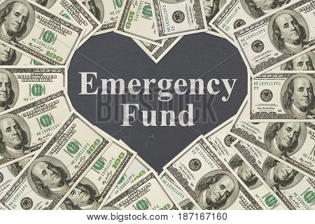 The love to have an emergency fund message One hundred dollar bill in the shape of a heart with a chalkboard heart with text Emergency Fund