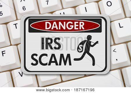 Tax scam danger sign A black and white danger sign with text IRS Scam and theft icon on a keyboard 3D Illustration