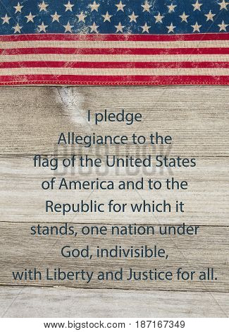 America patriotic message USA patriotic old flag and weathered wood background with text of the Pledge of Allegiance