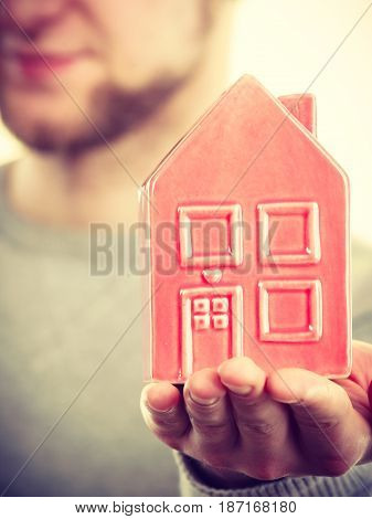 Young Man Holding House On Palm.