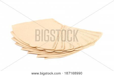 Twisted pile of multiple brown paper coffee filters isolated over the white background