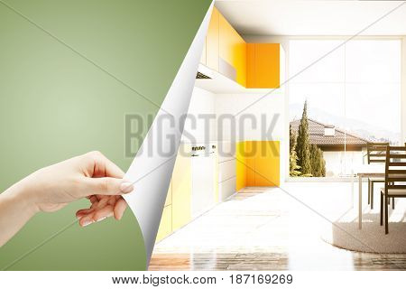 Girl's hand flipping abstract green page revealing new kitchen interior. 3D Rendering
