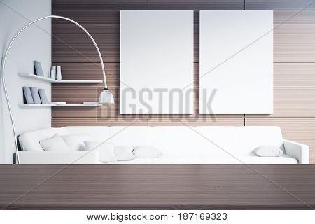 Close up of empty wooden table in modern interior with two blank posters creative floor lamp and shelves with items. Mock up 3D Rendering