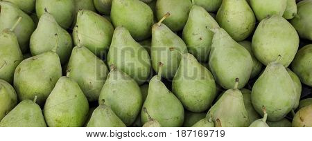 Pears on the counter for sale in a vegetable shop. Pears background. Horizontal. Crop.