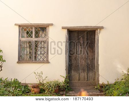 An Old Fashioned Door And Window Of A Cottage In England Essex Of The Uk Outside Very Clean And Whit