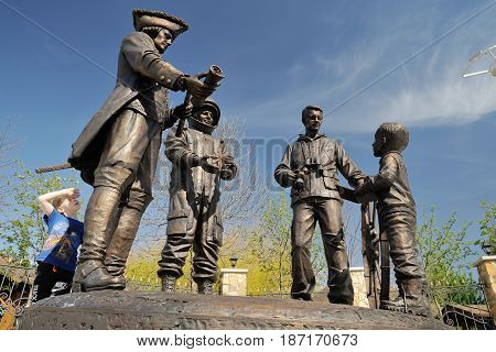 Orel Russia - April 29 2017: Russian traveler festival. Kid looking at first Russian monument to travelers horizontal