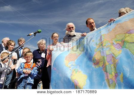 Orel Russia - April 29 2017: Russian traveler festival. People holding large world map horizontal