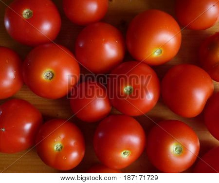 Tomato background. Red ripe tomatoes texture. Fresh organic products, pure eco food. Rural still life - closeup top view. Natural wallpaper.