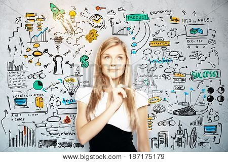 Portrait of thoughtful young woman on concrete background with business sketch. Brainstorm concept