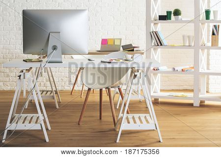 New office interior with device supplies and coffee cup on table