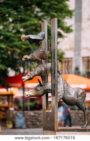 Riga, Latvia - July 1, 2016: Bronze statue depicting the Bremen Town Musicians located in Riga, Latvia. Famous Landmark. Travel Destination