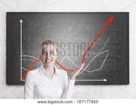 Enthusiastic Blond Woman Shows Growing Graph